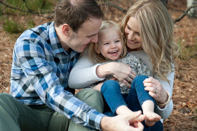 couple tickle their daughters feet Calgary portrait photography
