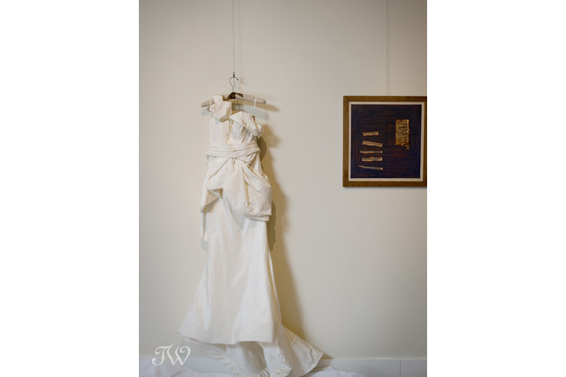vera wang bridal gown hanging in an art gallery Tara Whittaker Photography