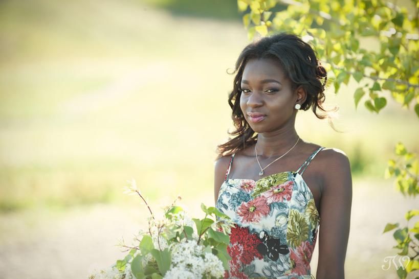 Bridesmaid in a floral print gown captured by Tara Whittaker Photography