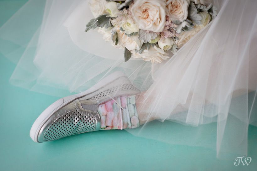 bride wearing flats for dancing captured by yyc photographer Tara Whittaker