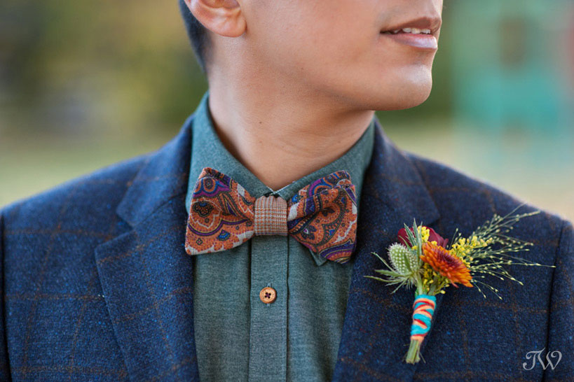 Boutonniere wrapped in colourful yarn captured by Tara Whittaker Photography