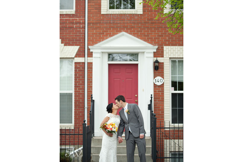 bride and groom kiss at the front door captured by Tara Whittaker Photography