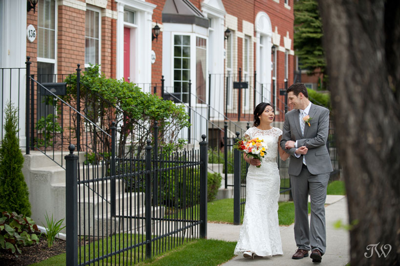 bride and groom stroll to ceremony captured by Tara Whittaker Photography