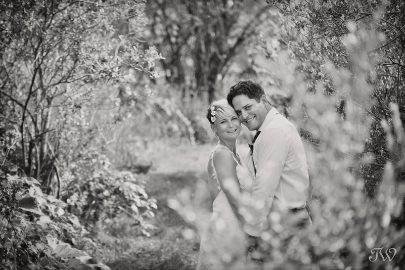 bride and groom pose in the trees