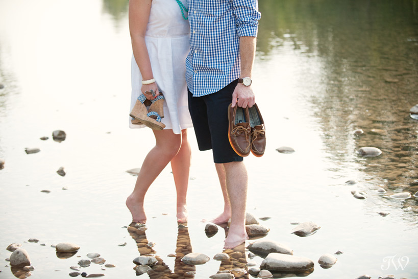 couple wading in the river captured by Tara Whittaker Photography