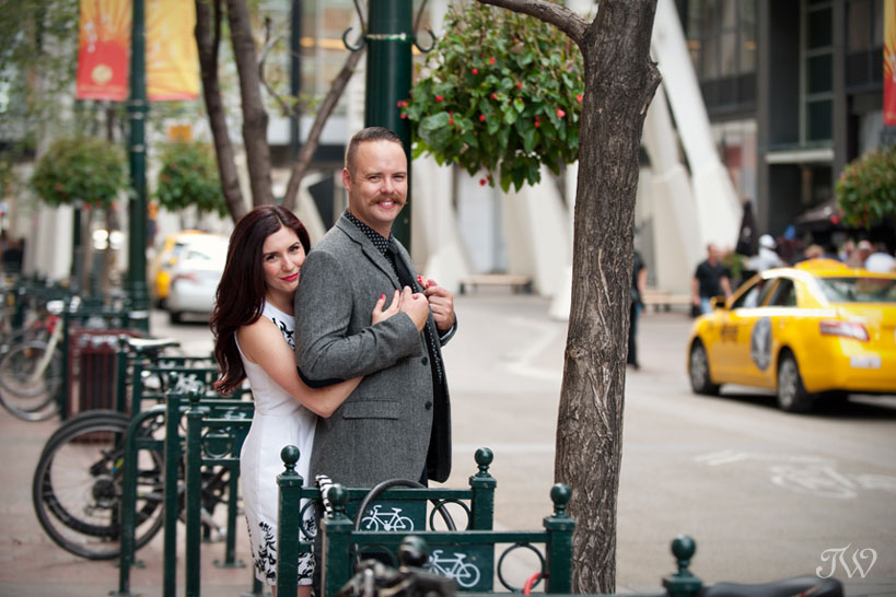 couple on Stephen Avenue for engagement session Calgary captured by Tara Whittaker Photography