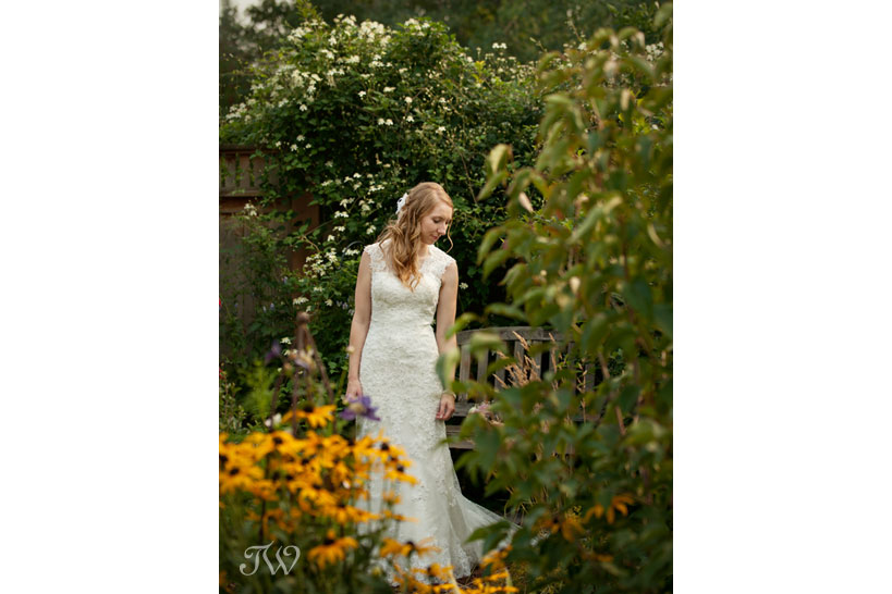 bride poses before her Heritage Park wedding captured by Tara Whittaker Photography