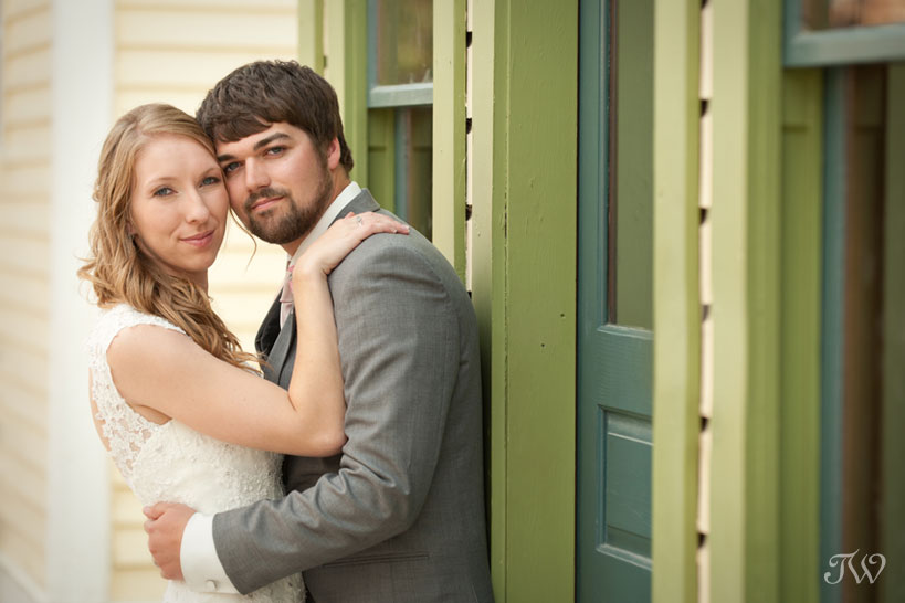 bride & groom on Main Street at Heritage Park captured by Tara Whittaker Photography