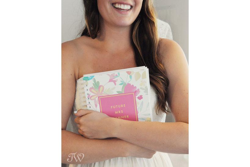 Bride holding the Future Mrs Planner wedding checklist