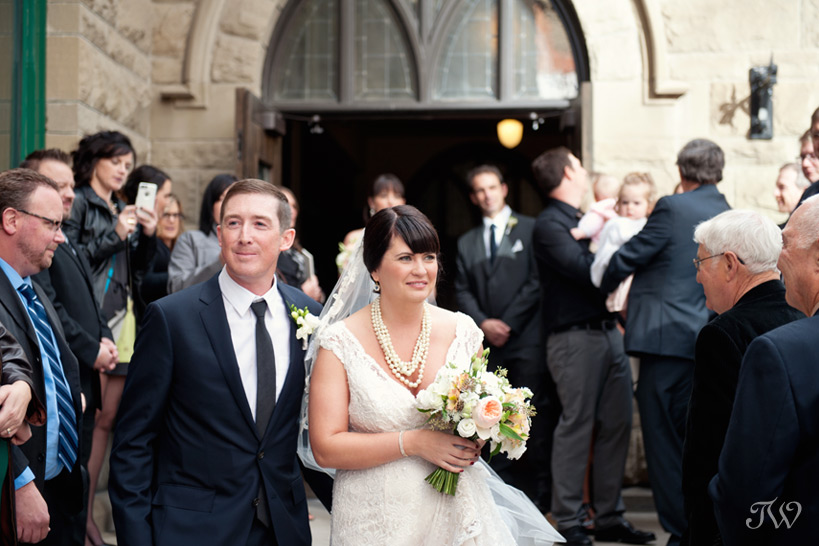 Calgary bride and groom exit the church captured by Tara Whittaker Photography