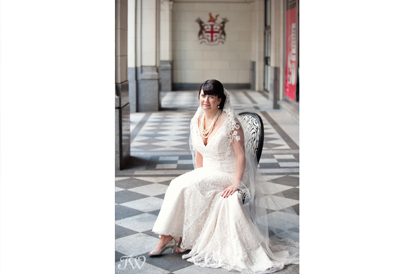 Bride poses on Stephen Avenue captured by Tara Whittaker Photography
