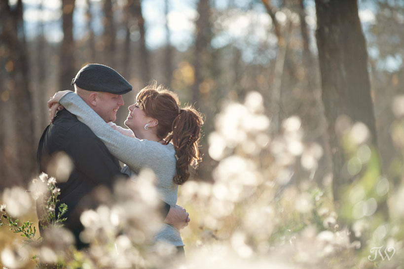 couple during their autumn engagement session in Fish Creek Park with Tara Whittaker Photography
