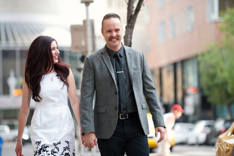 couple stroll in downtown Calgary captured by Tara Whittaker Photography