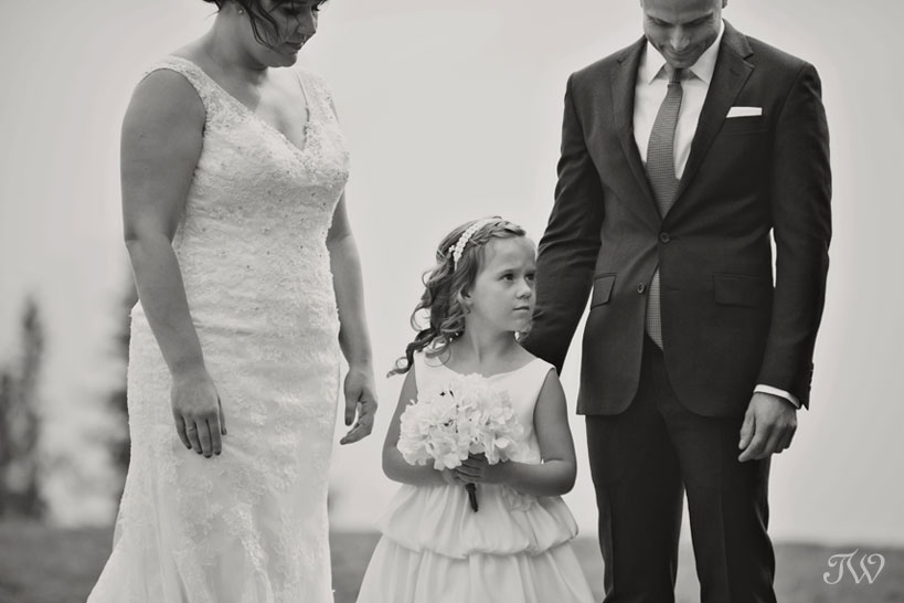 Flower girl during a Tunnel Mountain Reservoir wedding captured by Tara Whittaker Photography