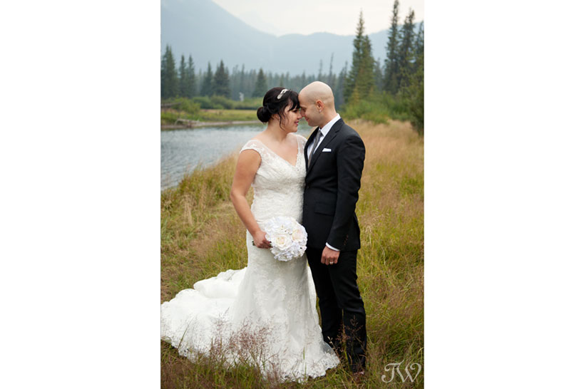 bride and groom at the Banff canoe club captured by Tara Whittaker Photography