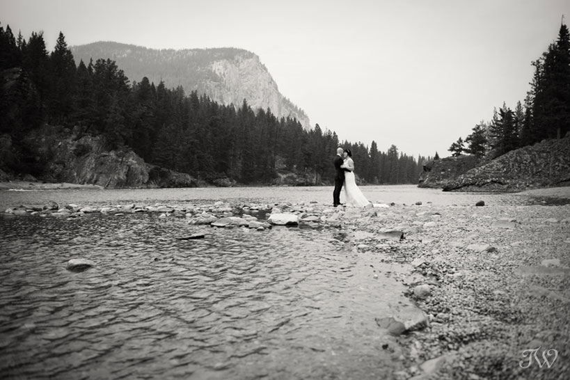 bride and groom at Bow Falls captured by Tara Whittaker Photography