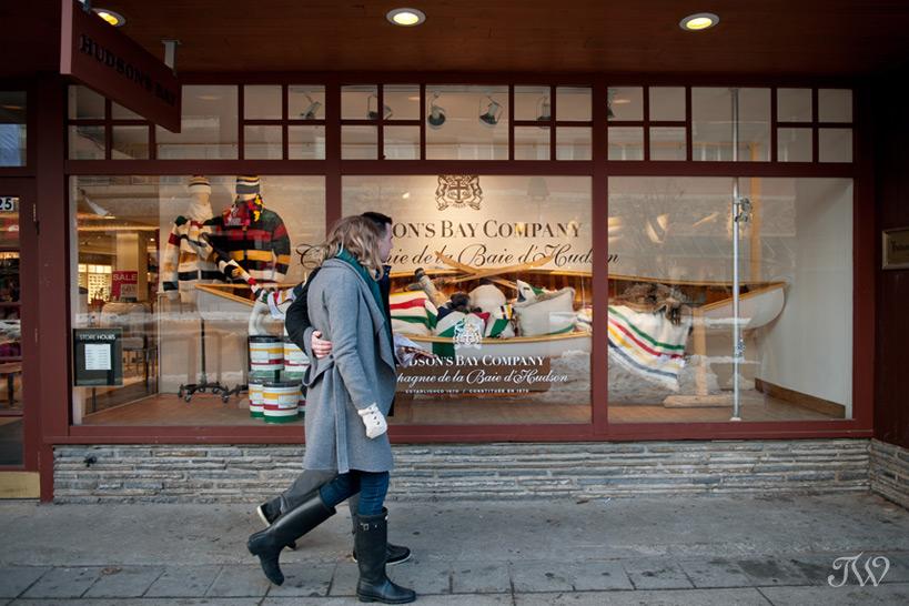 couple window shopping on Banff Avenue captured by Tara Whittaker Photography