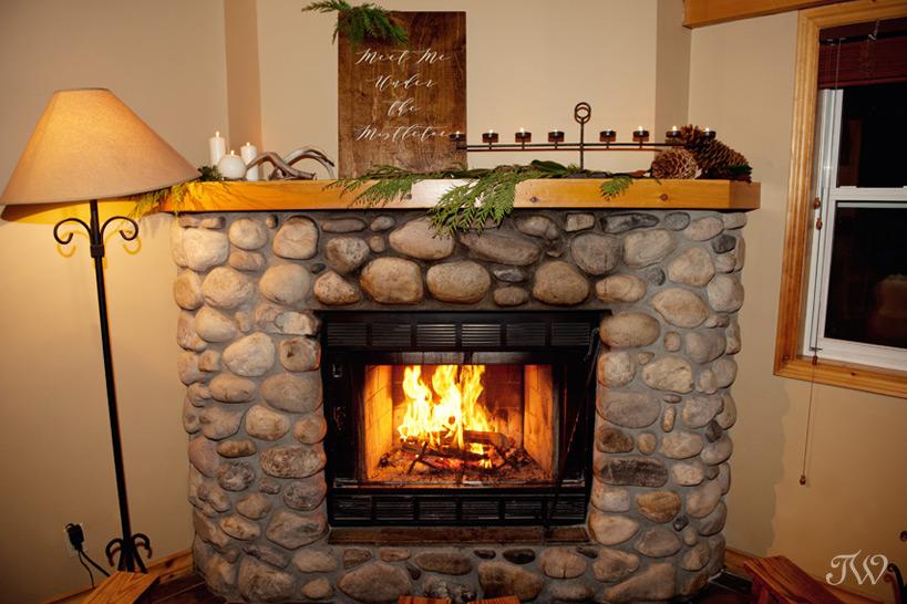Fireplace at Buffalo Mountain Lodge in Banff captured by Tara Whittaker Photography