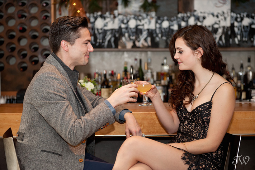 couple toasting at Bar C captured by Tara Whittaker Photography