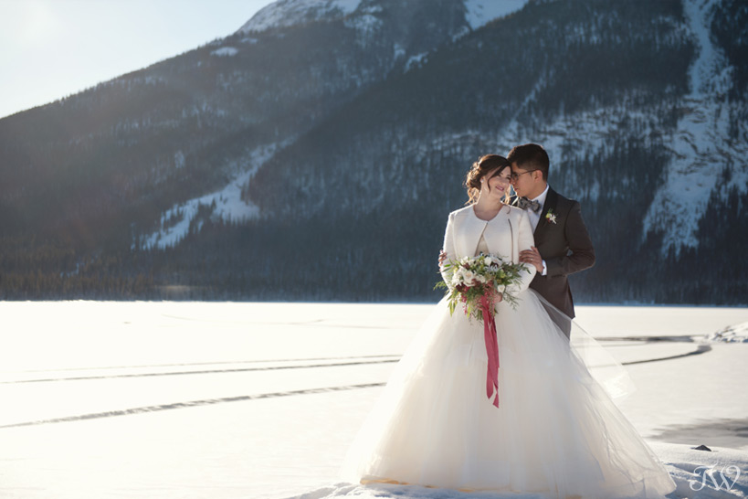 bride and groom at spray lakes captured by Tara Whittaker Photography