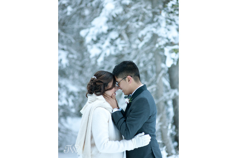 bride and groom embrace at their winter wedding captured by Tara Whittaker Photography