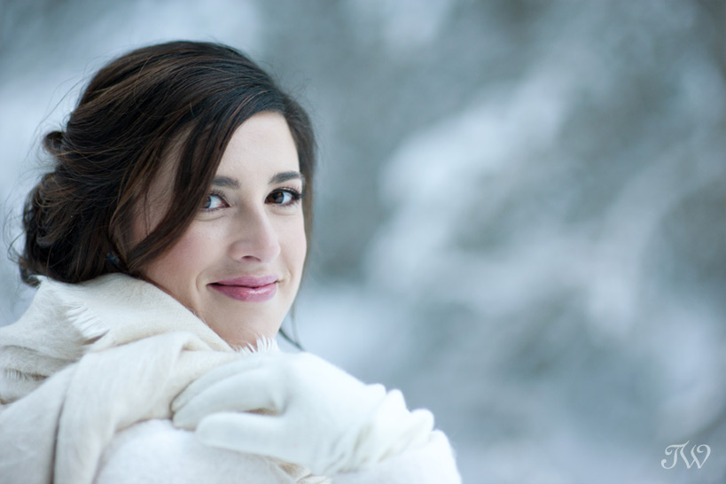 winter bride at her snowy wedding captured by Tara Whittaker Photography