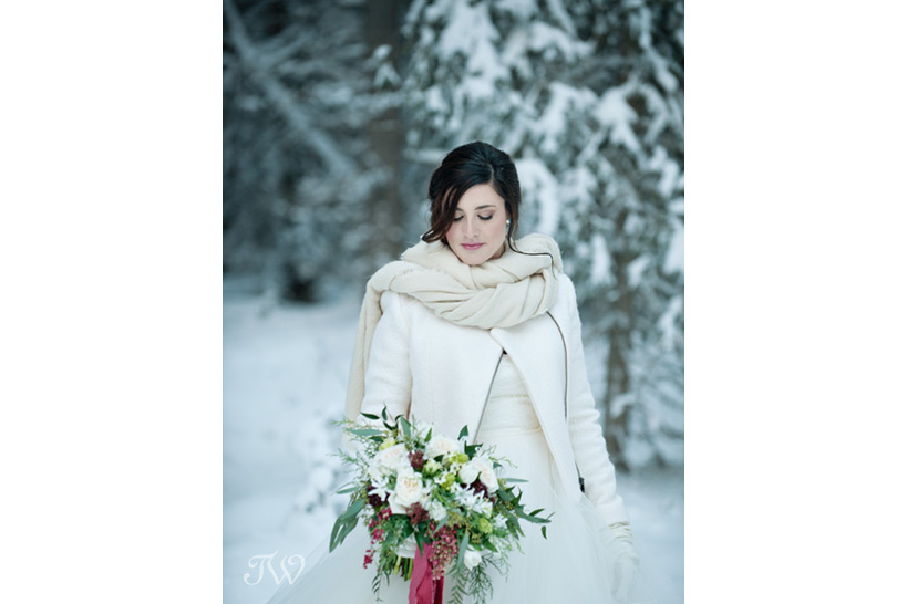 winter bride in the Rocky Mountains captured by Tara Whittaker Photography