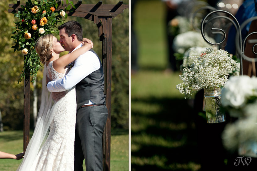 First kiss after a Fernie wedding ceremony captured by Tara Whittaker Photography
