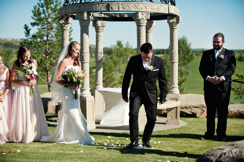 Groom breaks a glass after his wedding ceremony captured by Tara Whittaker Photography