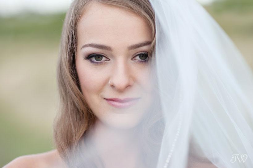 bride in a wedding veil captured by Calgary wedding photographer Tara Whittaker