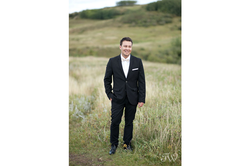 Groom in Nose Hill Park captured by Tara Whittaker Photography