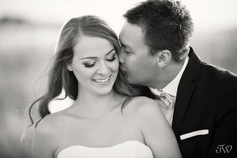 bride and groom embrace captured by Tara Whittaker Photography