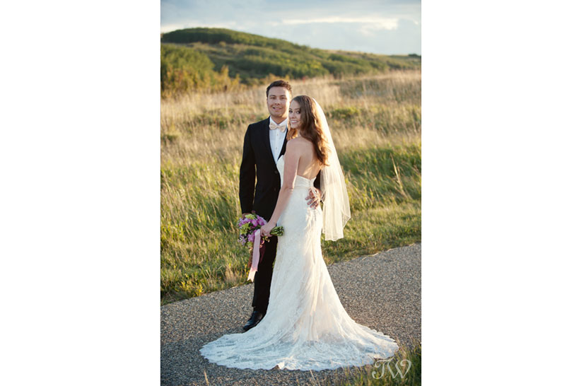 Bride and groom in Nose Hill Park captured by Calgary wedding photographer Tara Whittaker