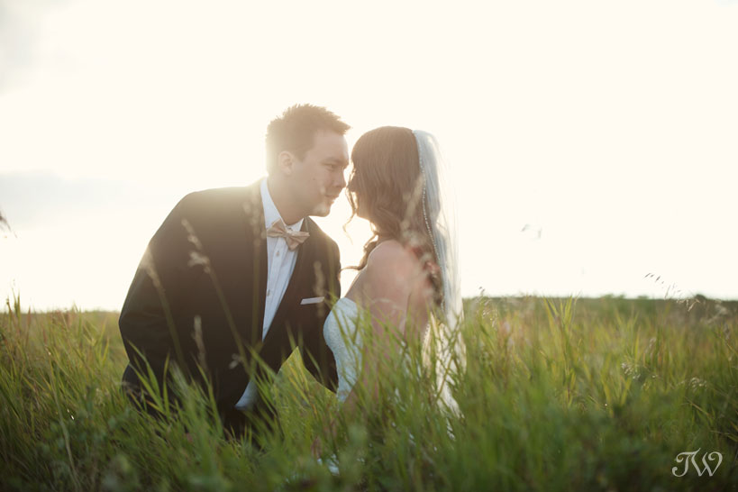 bride and groom at sunset captured by Tara Whittaker Photography