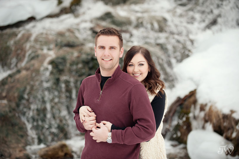 couple pose for winter engagement photos captured by Tara Whittaker Photography