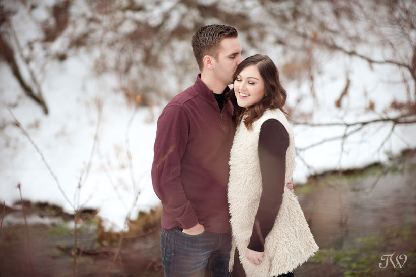 engaged couple pose for photos captured by Tara Whittaker Photography