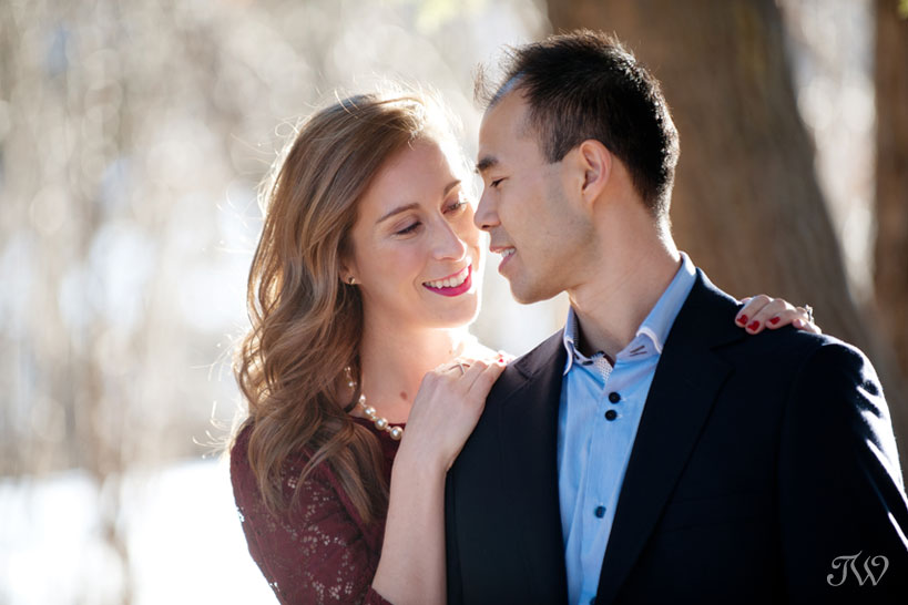 couple pose during their spring engagement session captured by Tara Whittaker Photography