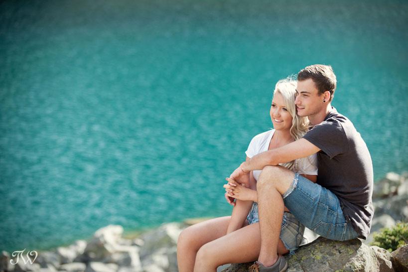 couple at Lake Agnes Alberta captured by Calgary engagement photographer Tara Whittaker