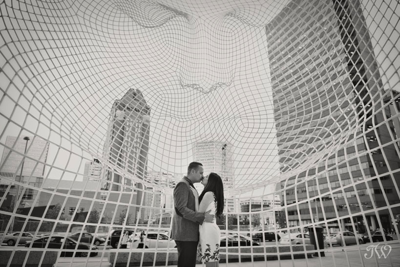 engagement photos at The Bow building in Calgary captured by Tara Whittaker Photography