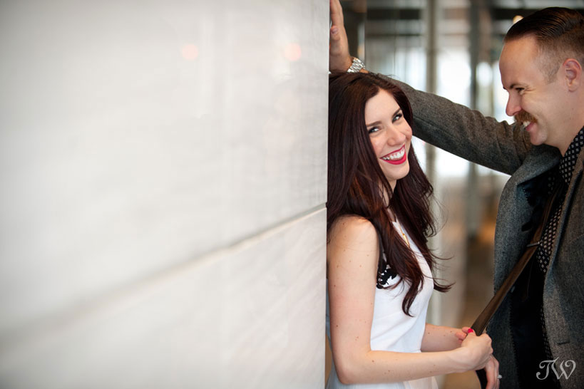 couple pose for engagement photos on Stephen Avenue captured by Tara Whittaker Photography