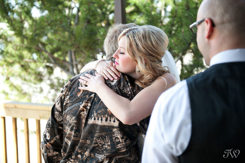 bride hugs her dad on her wedding day captured by Tara Whittaker Photography