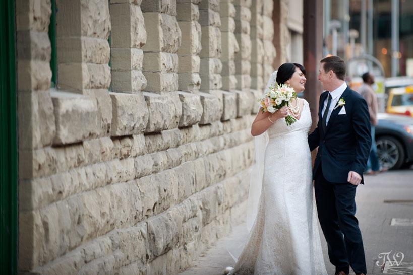 bride & groom on Stephen Avenue captured by Calgary wedding photographer Tara Whittaker