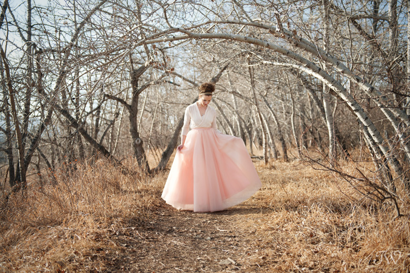 bride wearing a tulle skirt in peach tones captured by Tara Whittaker Photography