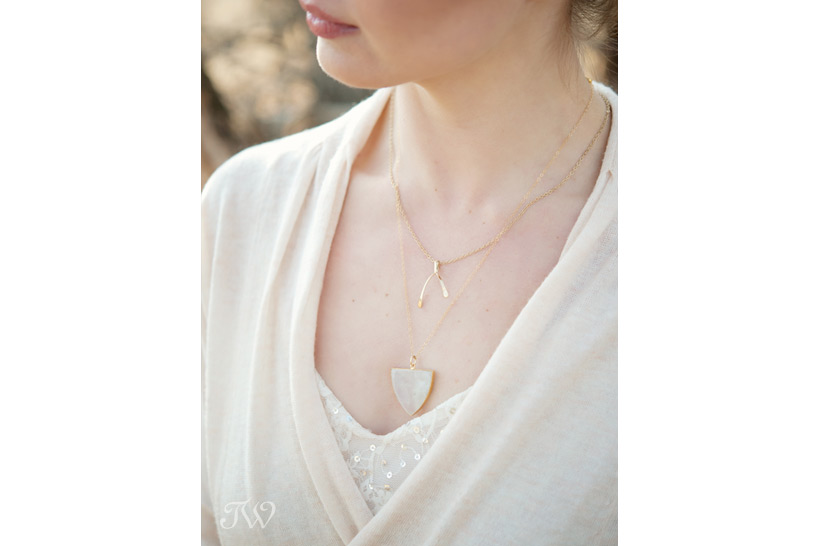 bride wears layered gold necklaces from Adorn Boutique captured by Tara Whittaker Photography
