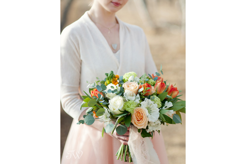 brides carries a spring bouquet from Flowers by Janie captured by Tara Whittaker Photography