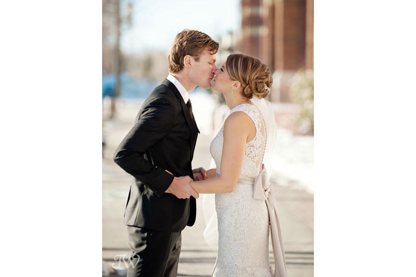 bride and groom kiss captured by Calgary wedding photographer Tara Whittaker