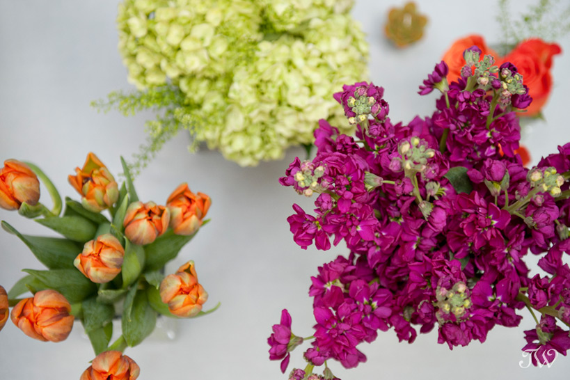 colourful florals from Flowers by Janie for a patio party captured by Tara Whittaker Photography