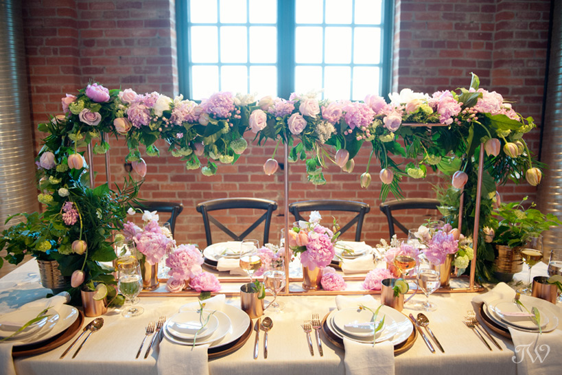 floral centrepiece with copper detail designed by Flowers by Janie