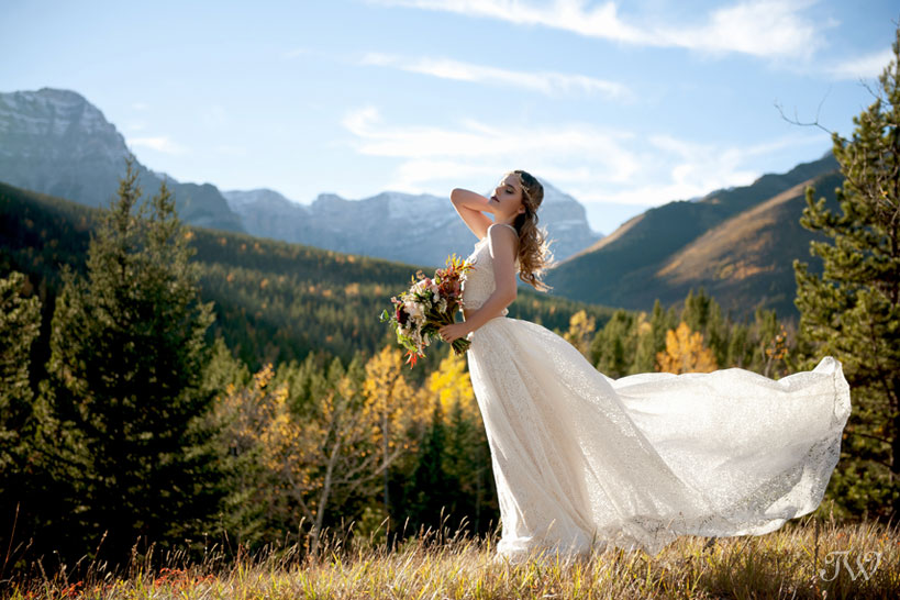 bohemian bride with the Rocky Mountains behind her captured by Tara Whittaker Photography