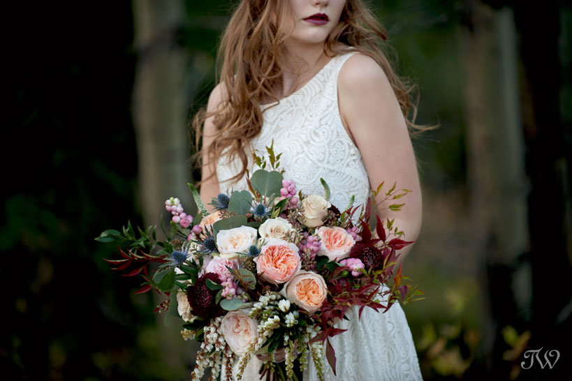 bohemian bride carries a fall wedding bouquet by Flowers by Janie